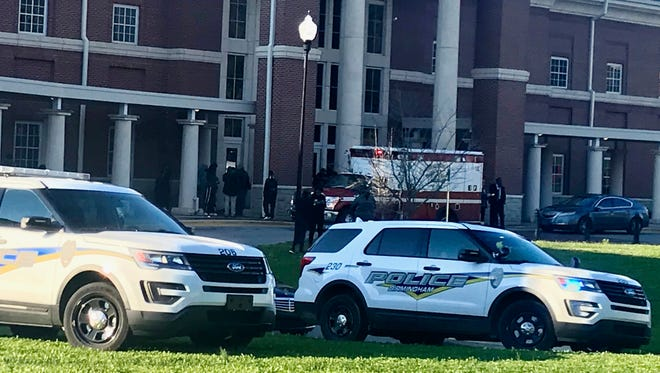 Authorities investigate the scene where a shooting occurred at Huffman High School in Birmingham, Ala.