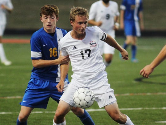 NCC;s Logan Muck, left, shown playing against Ryle's