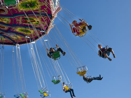 Guest soar through the air on a swing, April 13, 2014.