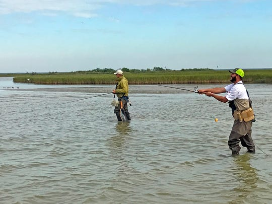 Redfish Lodge manager Brian Holden, on left, and Austin Pieprzyca caught big redfish in shallow sloughs such as this.