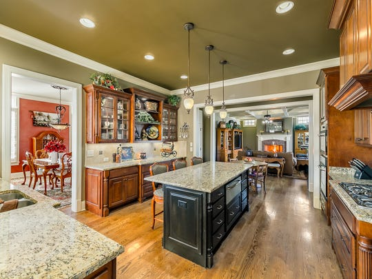 The custom finishes in the kitchen include warmly stained,