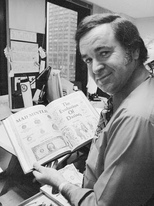 """""""Mad"""" magazine editor Al Feldstein works on page layout in his office at the magazine's New York headquarters in 1972. Feldstein, whose 28 years at the helm of Mad transformed the satirical magazine into a pop culture institution, died Tuesday, April 29, 2014. He was 88."""