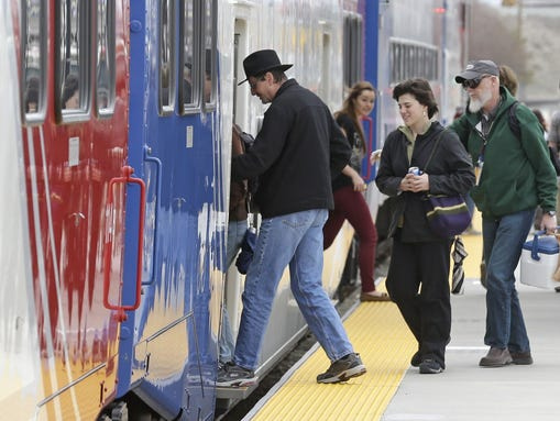 Commuters board the Frontrunner commuter rail line