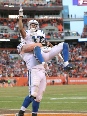 T.Y. Hilton (13) is lifted in the air by teammate and guard Jack Mewhort after catching the game winning touchdown in the final minute of the game against the Browns on Dec. 7, 2014.