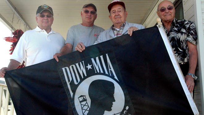 (L to R) Vietnam veterans Robert Reidel and Gary Jacobsen, World War II veteran Joe Zelazny (a former POW) and Skeeter Walker - whose brother, U.S. Air Force Major Lloyd Walker, was shot down during the Vietnam War and has been missing in action since February, 1967. Photo taken March 29, 2011 at Happy Wanderer RV Park in Indio.