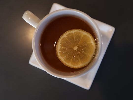 A hot toddy typically is made with bourbon or whiskey, hot water and honey. Some locales, like HoQ in the East Village, use lemon.