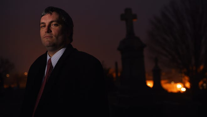 Brett Talley poses for a portrait at Holy Rood Cemetery in Washington in 2014.