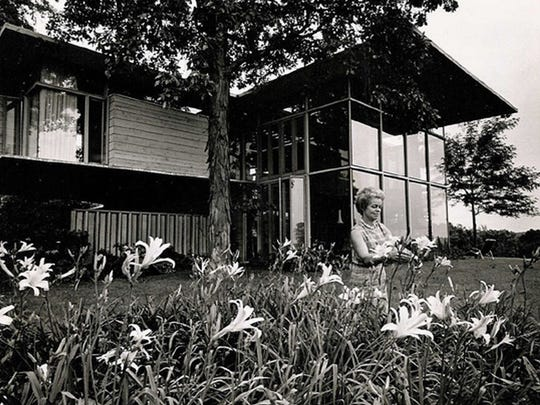 Nancy Seiberling is photographed among her day lilies at her home.