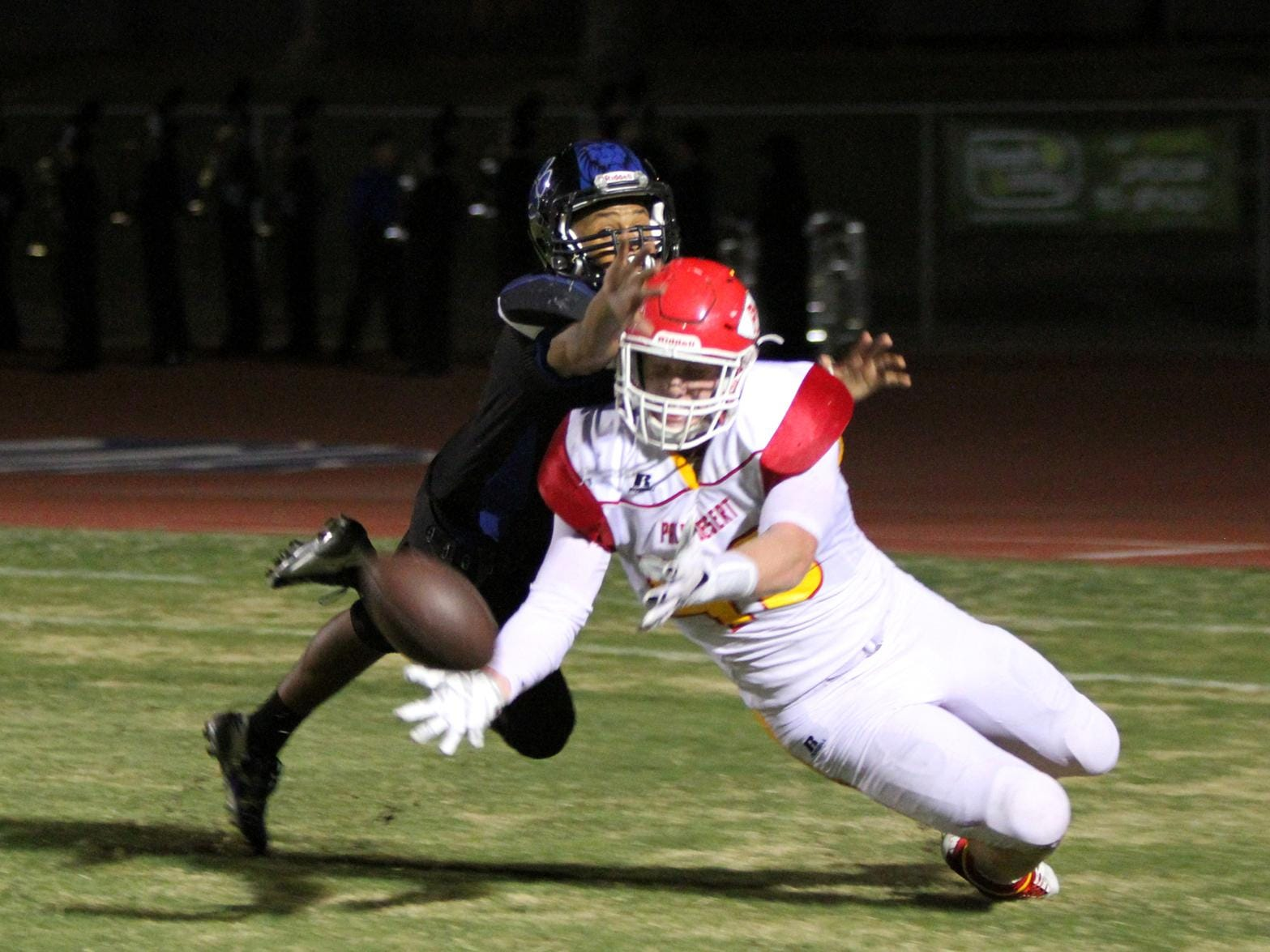 10/16/15 Taya Gray, Special to The Desert Sun Cathedral City's Timothy Miller defends a touchdown pass intended for Palm Desert's Tommy Jacobsson during the first half of the game in Cathedral City on Friday, October 16, 2015.
