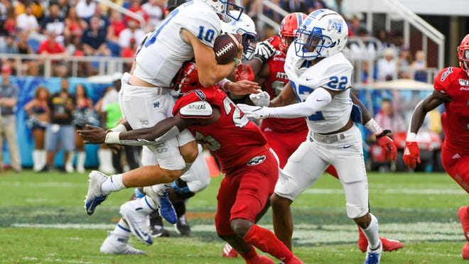 Florida Atlantic cornerback James Pierre tackles Middle Tennessee quarterback Asher O'Hara during a 28-13 victory at FAU Stadium on Oct. 12, 2019.