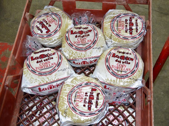 Finished corn tortillas baked and packaged at La Mejor