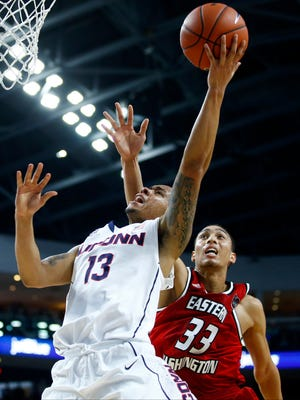 Connecticut Huskies guard Shabazz Napier (13) drives the ball to the basket against Eastern Washington Eagles forward Garrett Moon (33) during the first half at Webster Bank Arena.