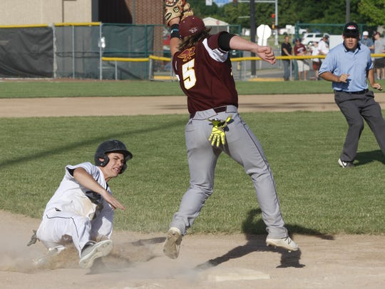 Ankeny Centennial's Davis Churchman steals third base during the first game of Wednesday's doubleheader against visiting Ankeny. Churchman went 2-for-4 with a double, scored two runs, and had three of his team's seven stolen bases in the Jaguars' 8-1 victory.