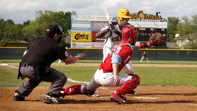 Kickapoo's Tristan Stevens looks at a ball on the outside corner into the glove of Glendale catcher Dayton Climer during a 2015 game at Kickapoo High School.