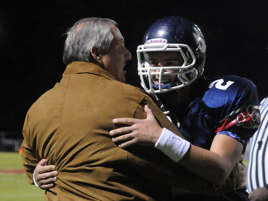 Trinity kicker Andy Pappanastos hugs father Paul after