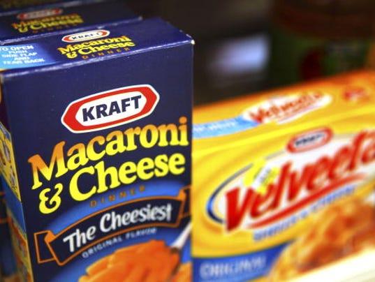 Cadbury Accepts Kraft's Raised 11.9 ($19.7) Billion Pound Offer