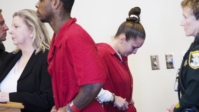 Cash Feenz member Roderick Washington, left, listens during his resentencing hearing while Ashley Toye exits the courtroom Monday. Both were resentenced to life in prison for the murders of Jeffrey and Alexis Sosa in 2006.