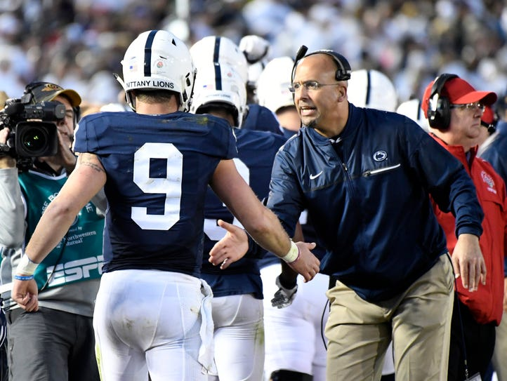 Trace McSorley (9) and coach James Franklin are riding