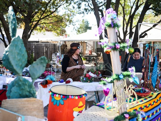 Vendors sell crafts at the Open House event Saturday, Nov. 25, 2017, at the Old Chicken Farm Art Center.