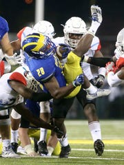 Delaware running back Thomas Jefferson is sent airborne