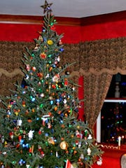 A Christmas tree in the Victorian home of Tammy and Greg Jackan featured in the 2012 Holiday Home Tour.