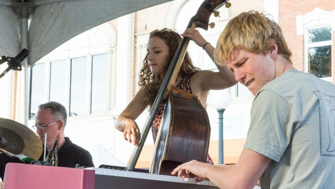 Butterfly Dreams plays the College Stage on the final day of Jazzfest. Sunday, July 3, 2016.
