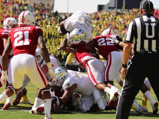 Oregon running back Royce Freeman (21) jumps over Nebraska Cornhuskers' defense for a touchdown in the first half at Autzen Stadium. Oregon won 42-35.