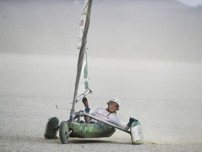 Sven Kraja slowing works to slow himself down after winning a round of the Landsailing World Championships on Monday, July 14, 2014 on Smith Creek Playa, Nev.