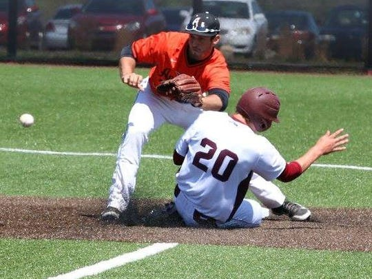 Earlham's Matt Barger (20) slides safely into second base.