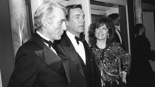 """Jill St. John, right, with Robert Wagner, center, and Rod McKuen, left, attend a party for """"Night of 100 Stars II,"""" in New York, on Feb. 18, 1985. McKuen, the husky-voiced """"King of Kitsch"""" whose music and verse recordings won him an Oscar nomination and made him one of the best-selling poets in history, has died on Thursday, Jan. 29, 2015. He was 81."""