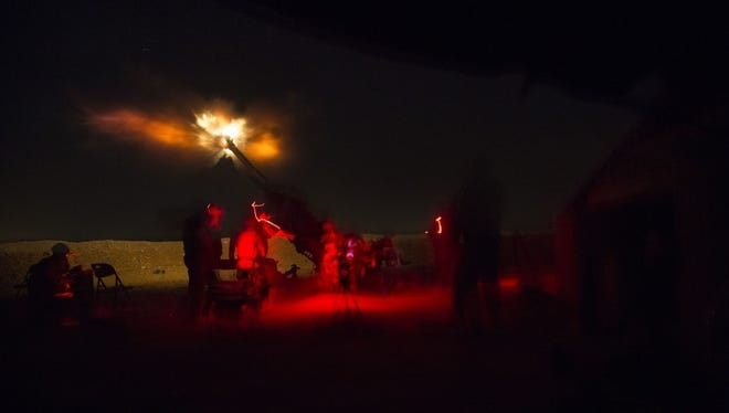 U.S. Soldiers assigned to 1st Battalion, 320 field Artillery Regiment, 2nd Brigade Combat Team, 101st Airborne Division (Air Assault) fire an M777 howitzer from Kara Soar Base, Iraq, during a night operation in support of the Iraqi Army June 3, 2016. Fire missions are one way the Coalition enables the Iraqi Army to defeat the Islamic State of Iraq and the Levant. Advise and assist teams enable Iraqi security forces as they prepare for upcoming operations by sharing intelligence and helping them develop security strategies and targeting plans. (U.S. Army Photos by Spc. Jaquan P. Turnbow/Released
