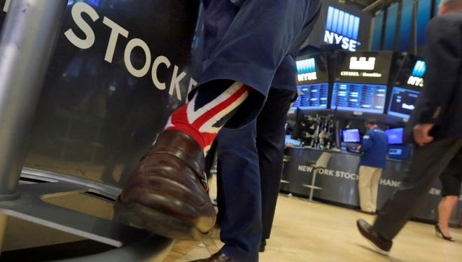 Specialist Michael Pistillo wearing Union Jack socks as he worked on the floor of the New York Stock Exchange in June. In 2016, stocks traveled a bumpy road, including the surprising outcome of Britain's vote to leave the European Union.