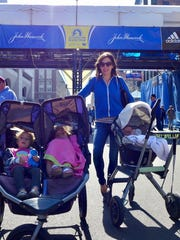 Cassidy Bentley with her children at the finish line