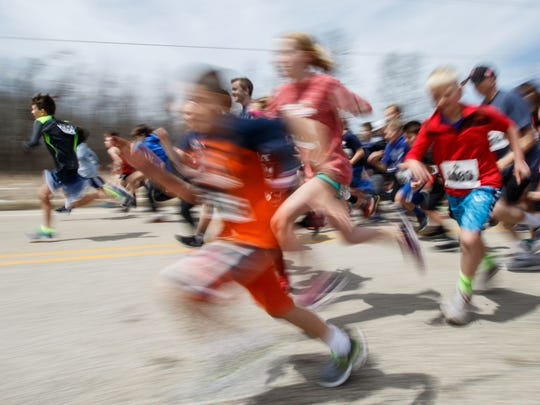 808ba7bd Menomonee Falls hosts a run/walk every Father's Day, rain or shine, to Buy  Photo