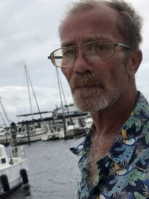 """Wyatt Kittleson lives on his boat, """"C'Est La Vie"""" at the Fort Myers Yacht Basin"""