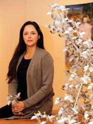 "El Paso artist Margarita Cabrera sits by her ""Uplift"""
