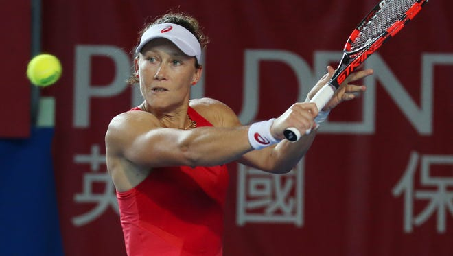 Samantha Stosur of Australia returns a shot against Monica Puig of Puerto Rica during the second round at the Hong Kong Open.