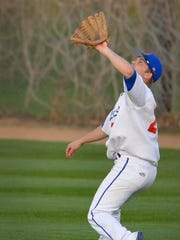 St. Cloud Apollo's Brandon Bissett (21) makes a catch for an out in the third inning against St. Cloud Tech Friday night, April 22 at Dick Putz Field.