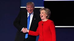 Hillary Clinton shakes hands with Donald Trump at the