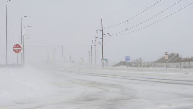 Visibility is low on Marion Road near the Interstate 90 exit in Sioux Falls on Thursday.