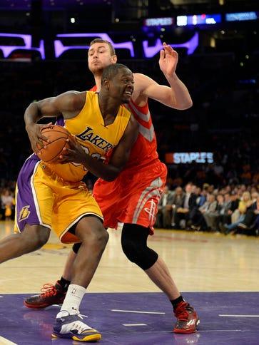 Lakers forward Julius Randle drives during the season-opener