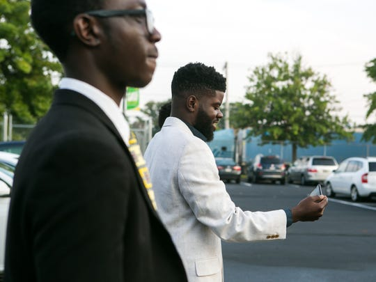 Several dozen black males from around the area dress in suits for Suit Up. Show Up., an event during which they stepped up to model what success looks like by welcoming young students at EastSide Charter School on their first day of school.