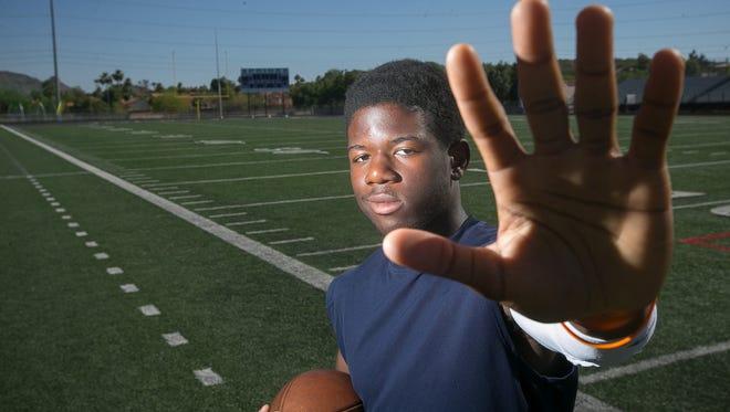 North Canyon high school football player John Okwoli in Phoenix on Tuesday, June 2, 2015.