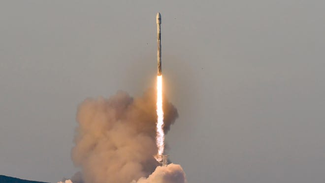 A SpaceX Falcon 9 rocket lifts off March 30, 2018, from Vandenberg Air Force Base in California carrying 10 Iridium NEXT communications satellites into orbit.