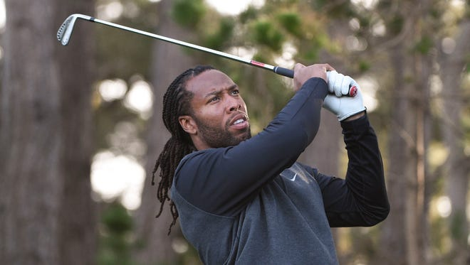 Larry Fitzgerald watches a shot during the 2016 AT&T Pebble Beach National Pro-Am at Spyglass Hill.