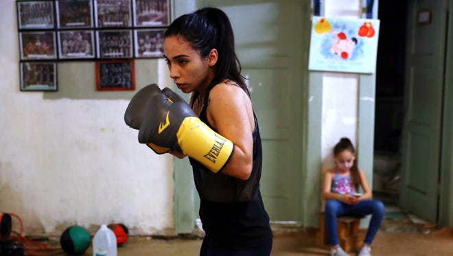 Felycia Luna, 26, works out Tuesday, Feb. 20, 2018, at the Corpus Christi Police Officers Association Boxing Club, while her daughter Audrey Rivas, 8, watches. Luna is the first woman boxer from the Coastal Bend to compete in the Texas State Golden Gloves competition, scheduled Feb. 28.