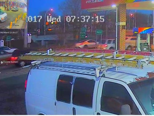 Surveillance photos showing the suspected red pick-up