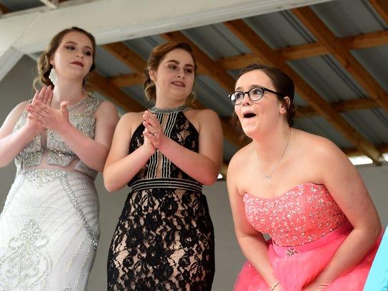 Ridgewood senior Keirstan Hall, 17, (right) reacts