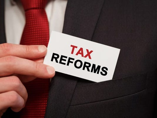 businessman-card-tax-reform-corporate-deduction-credit-repatriation-getty_large.jpg