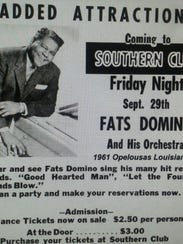 A billboard advertises Fats Domino's 1961 performance